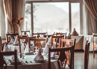 brown wooden dining set inside room