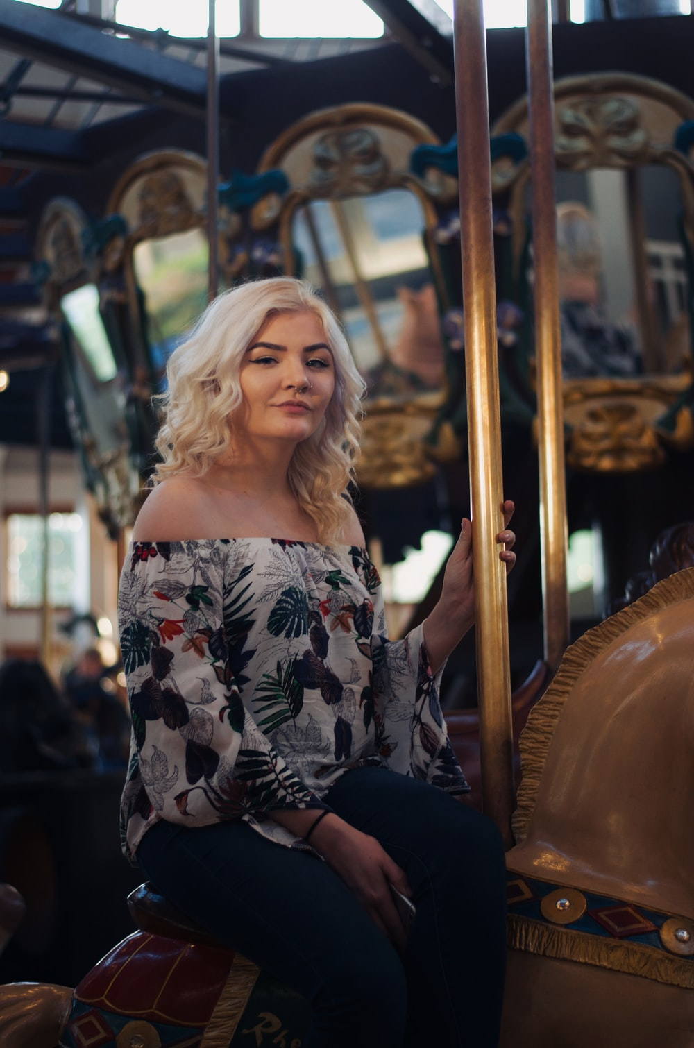woman wearing gray floral off-shoulder blouse