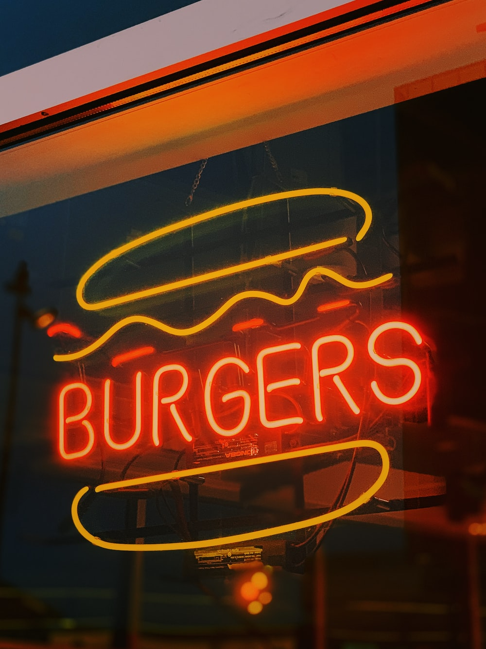 red and yellow Burgers neon sign