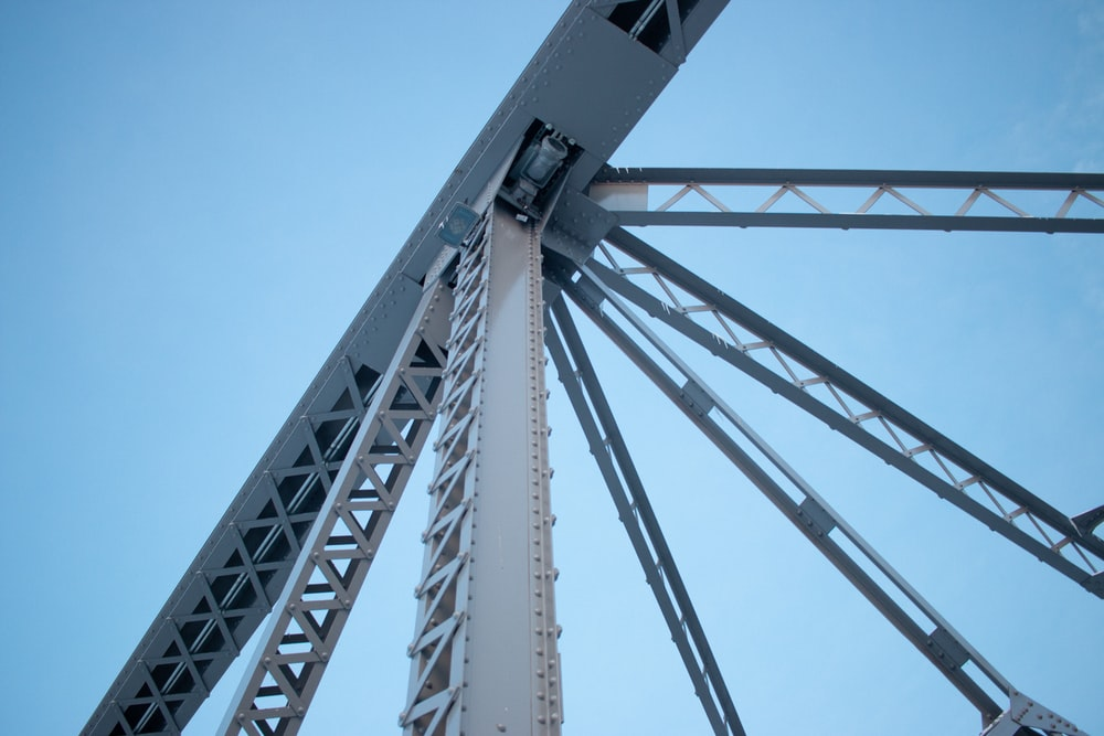 low-angle photography of white steel frame