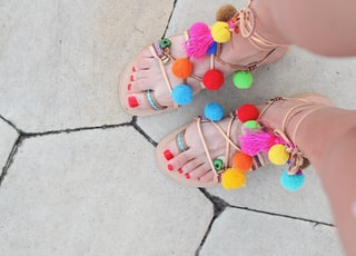 woman wearing multicolored flat sandals