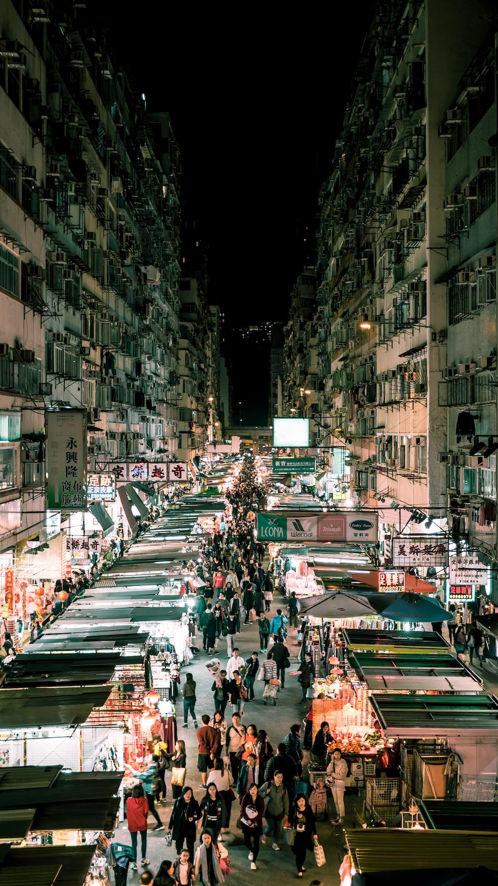 people walking on the streets between buildings