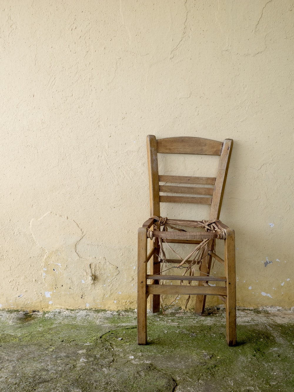 brown wooden ladder back chair