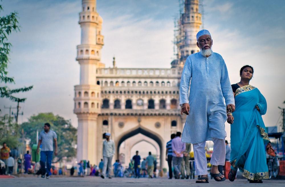 people walking near mosque during daytime