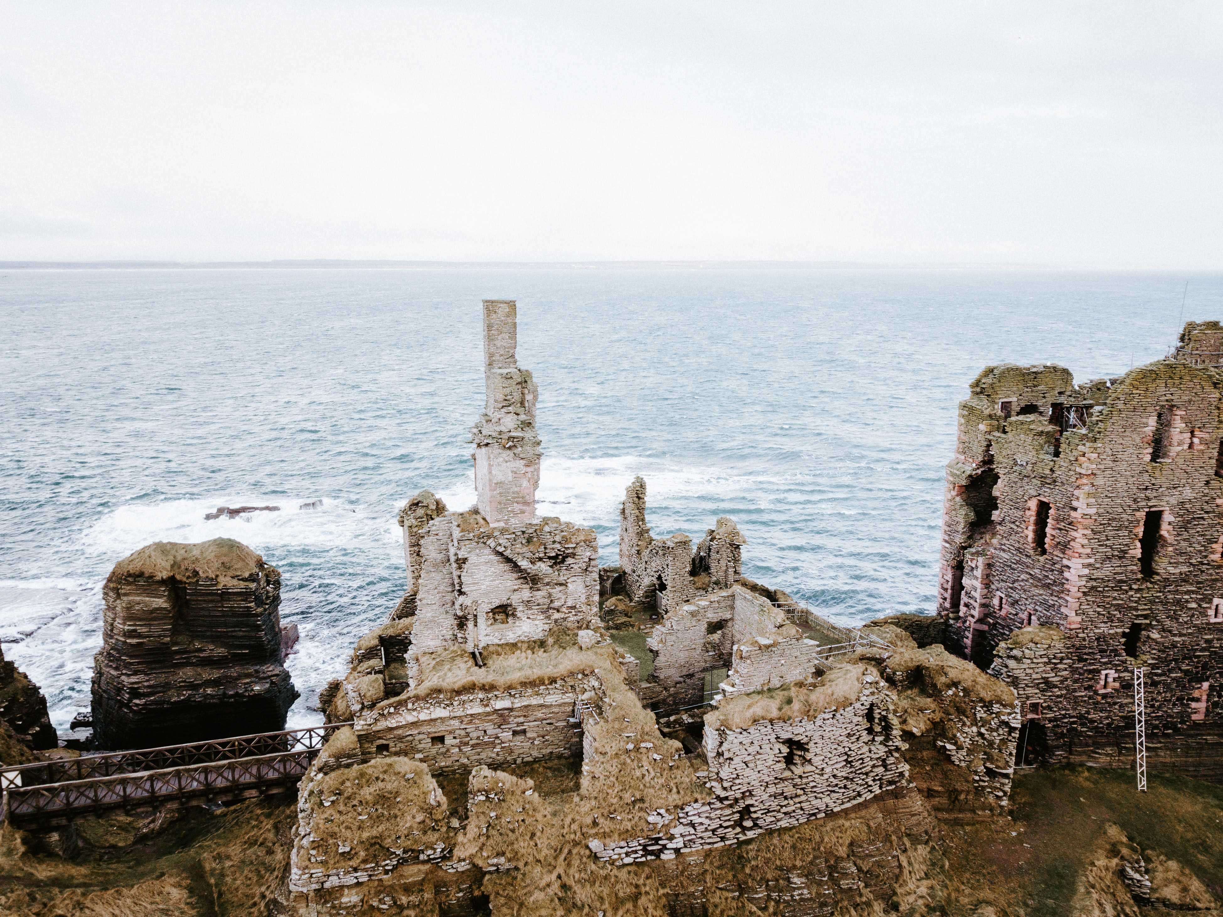 aerial photo of concrete abandoned buildings near sea at daytime