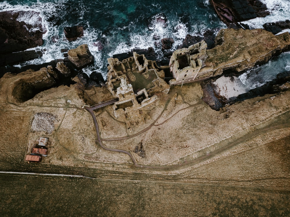 aerial photography of ruins by cliff