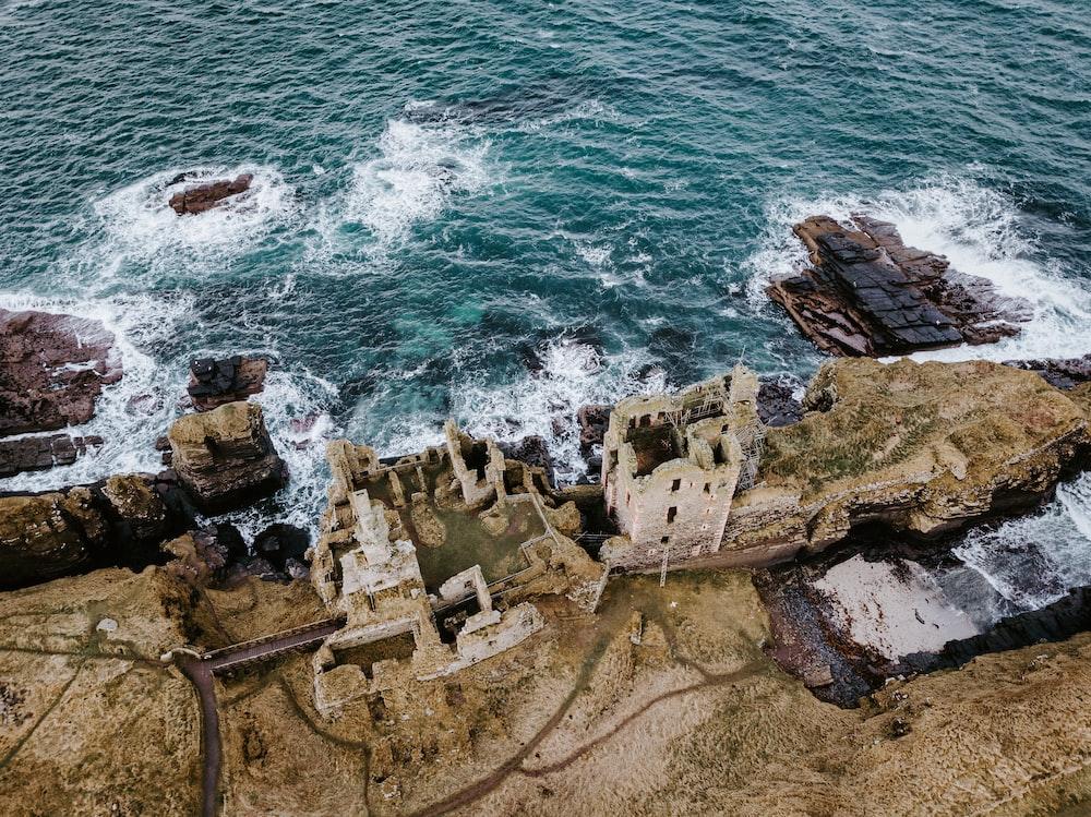 brown castle ruins across sea