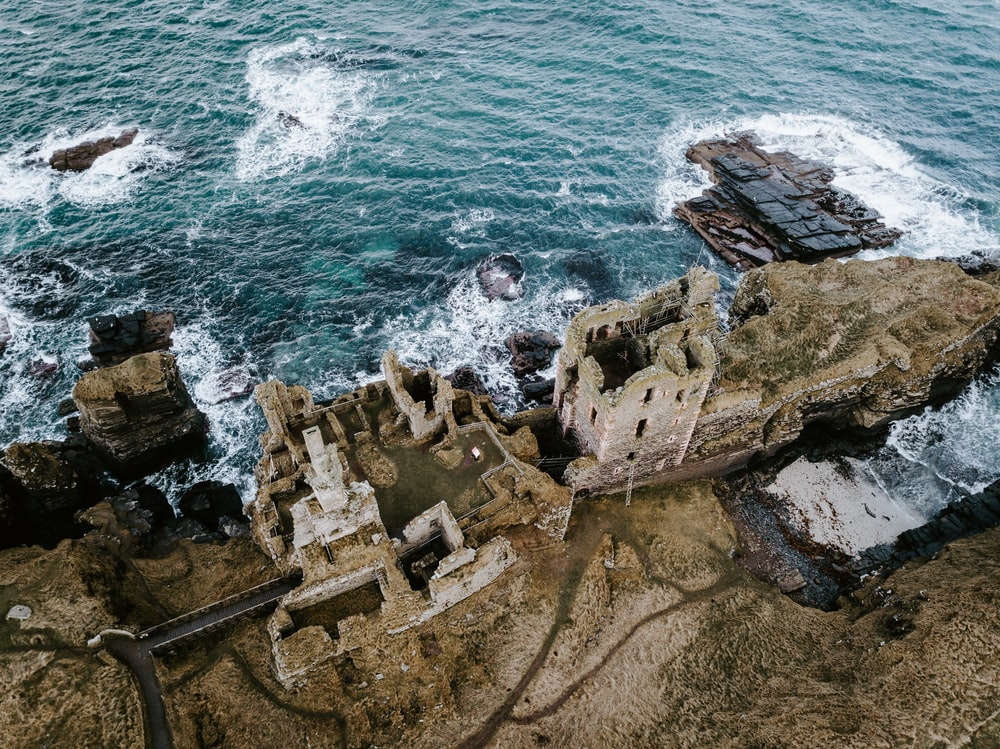 aerial photography of castle near body of water