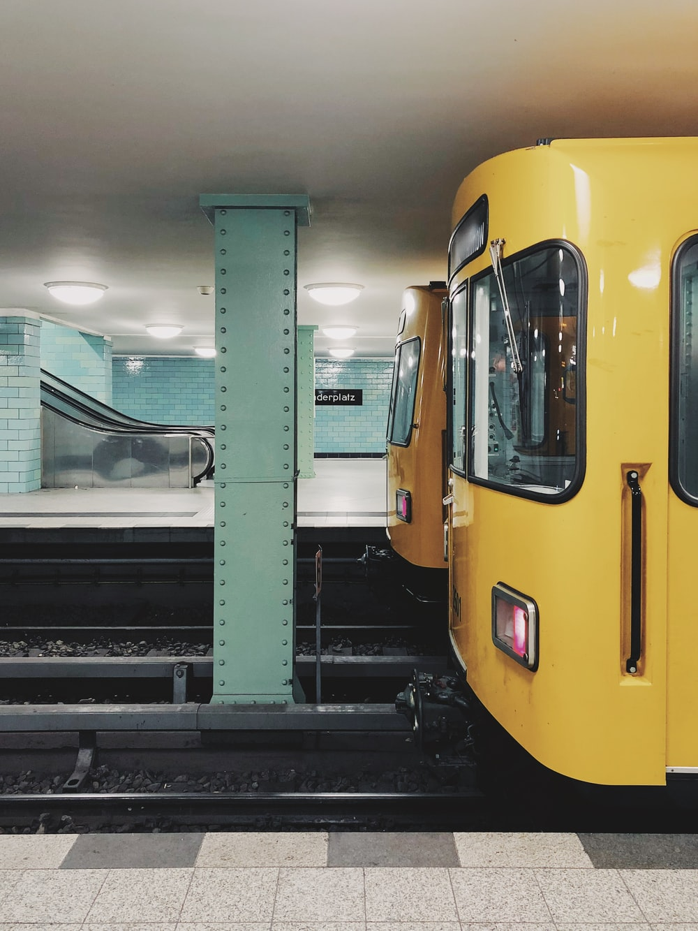 yellow train close-up photography