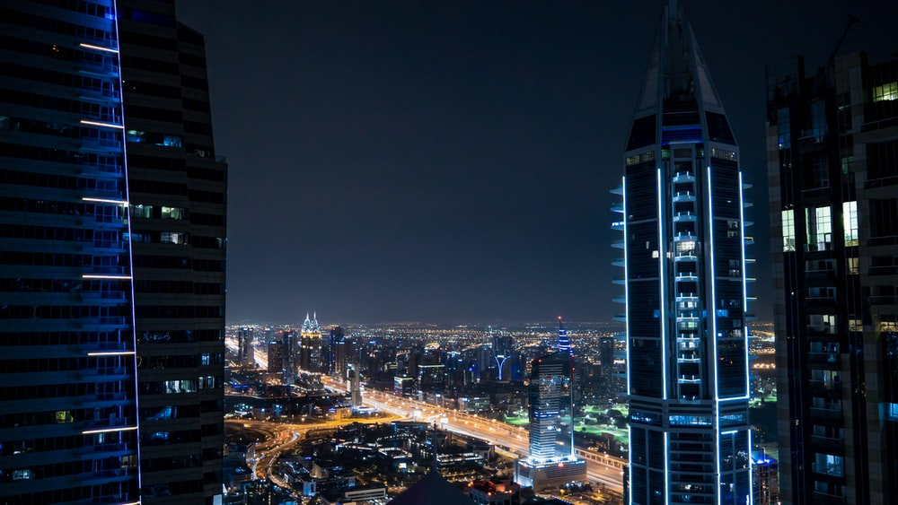 top-view of lighted city buildings during night time