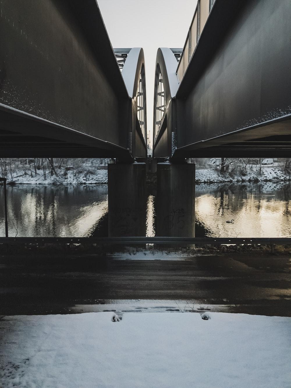 river under bridge at daytime