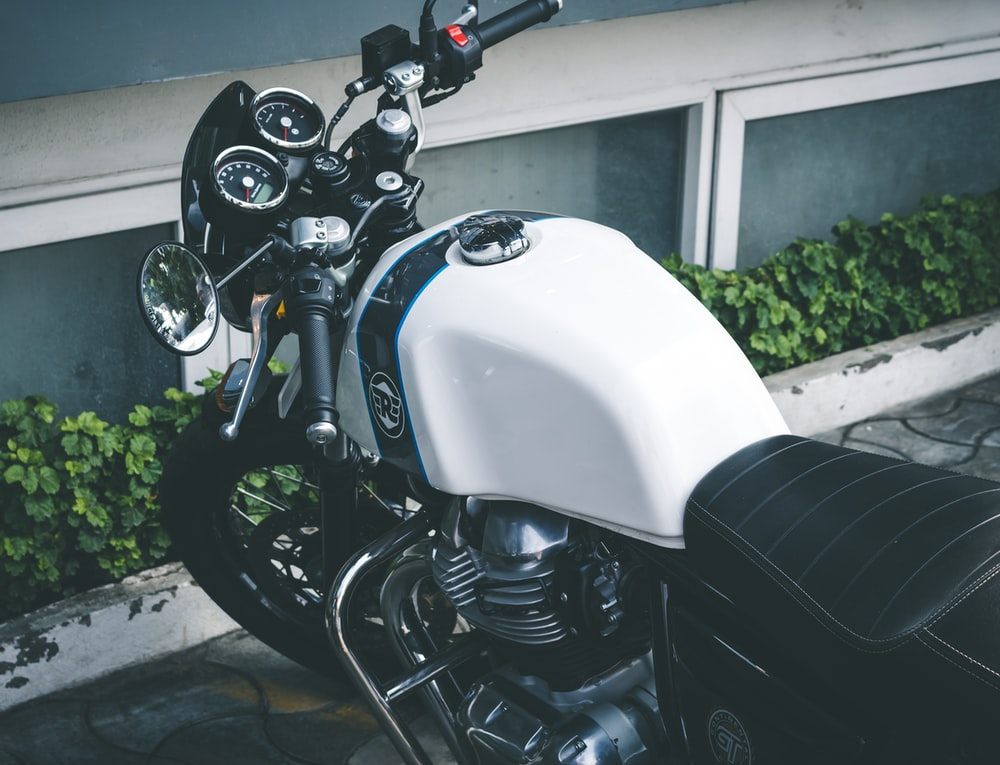 white and black standard motorcycle