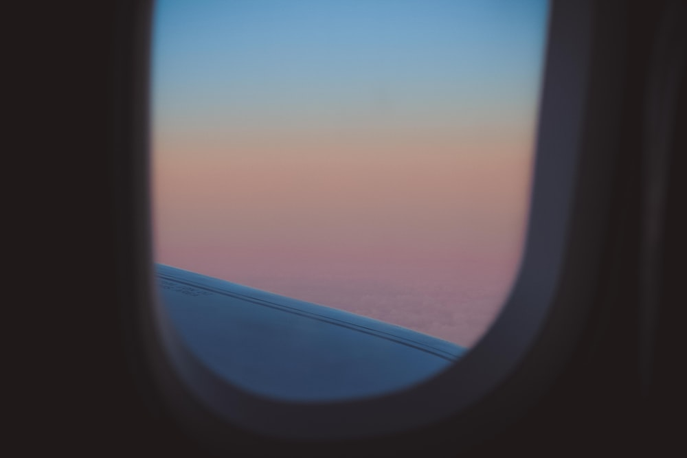 commercial plane window with view of ocean