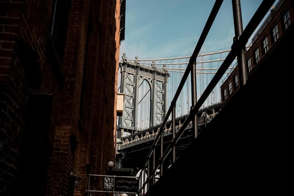 low-angle photo of Manhattan bridge during daytime