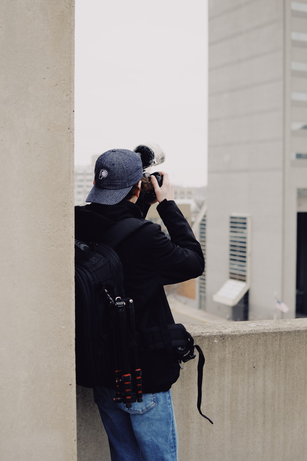 man taking photo of concrete building
