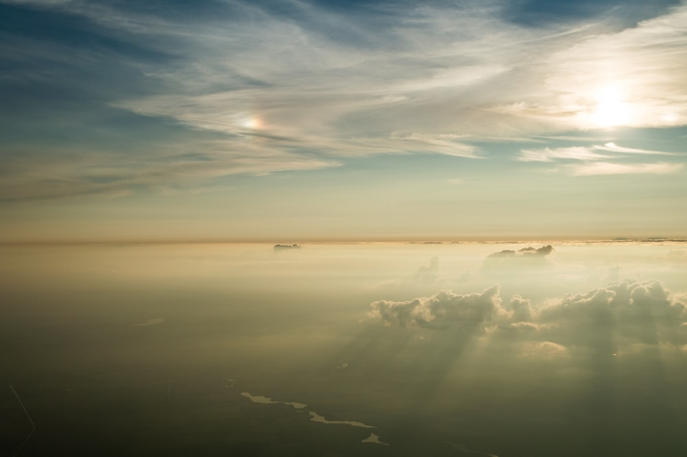 aerial photo of sun behind the clouds