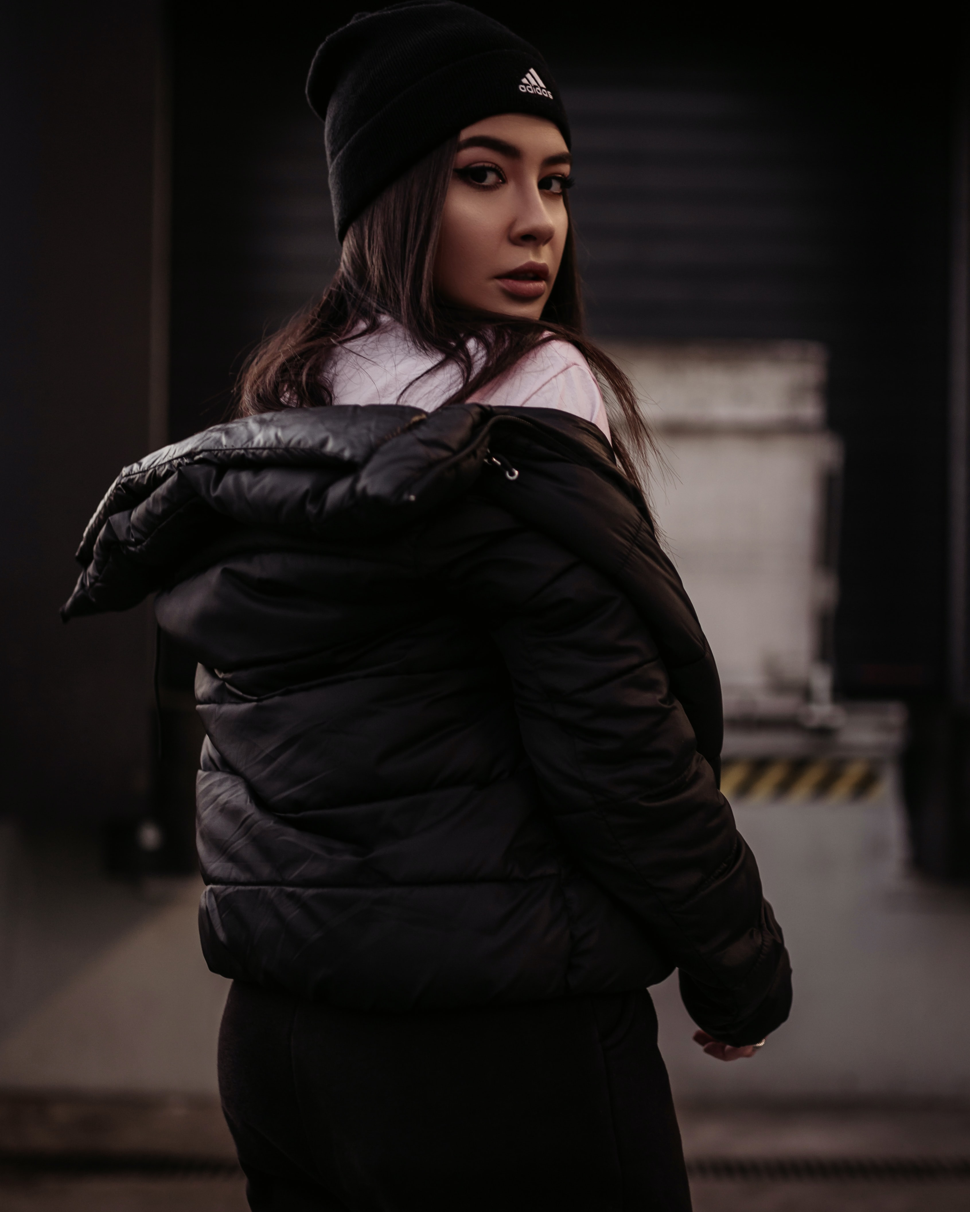 woman in black jacket turning head back