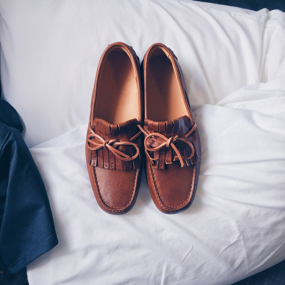 flat lay photography of two brown leather loafers