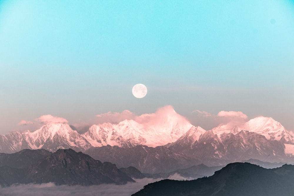 white moon over mountaines