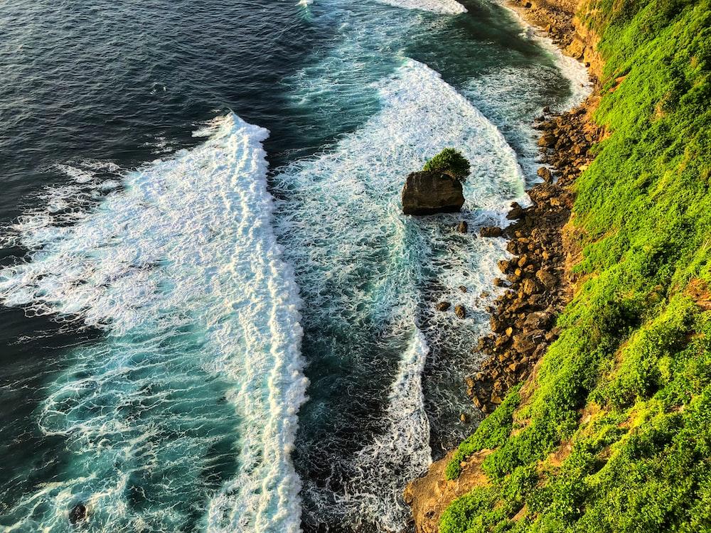 aerial view of seashore near mountain