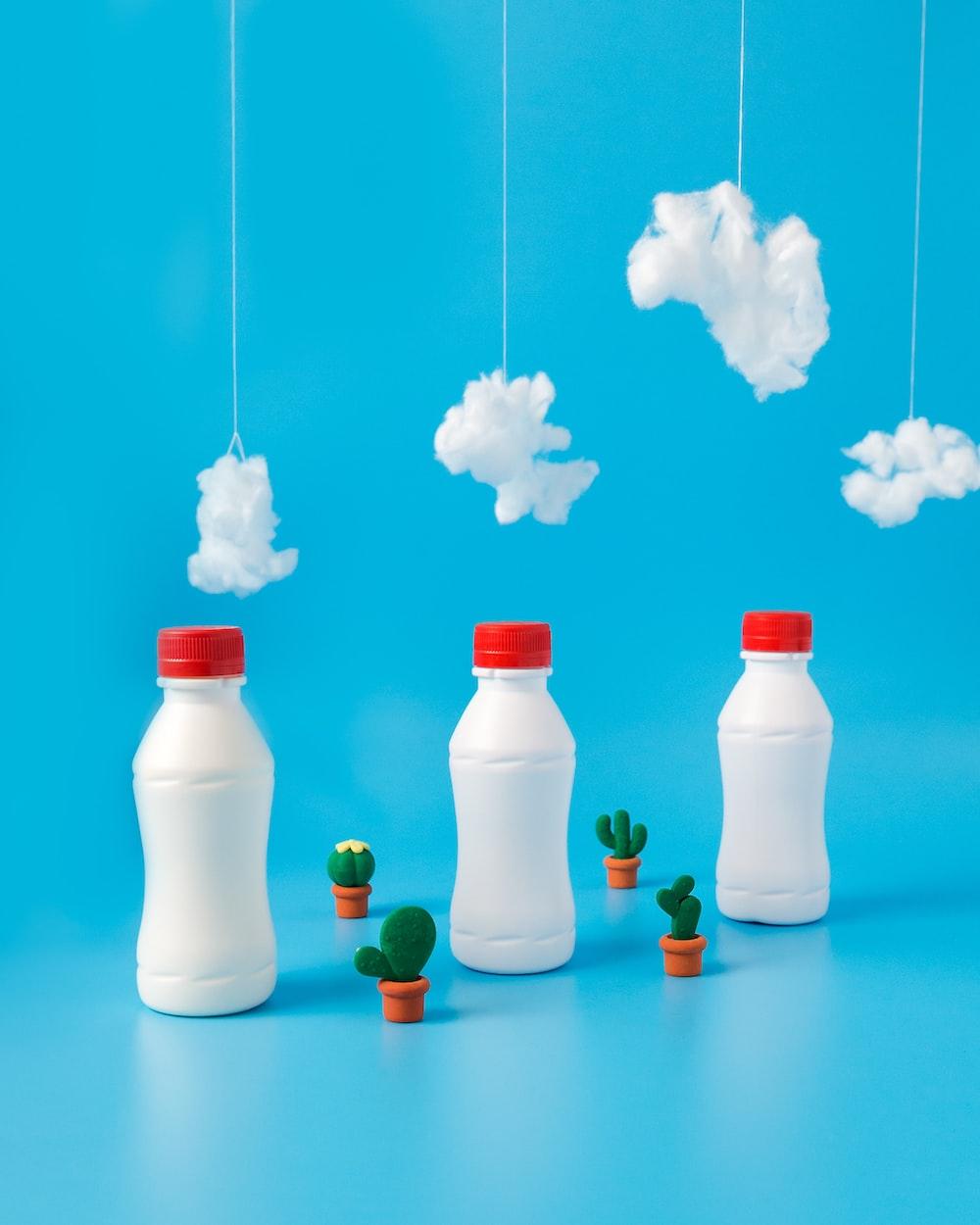 three white plastic bottles under white cottons