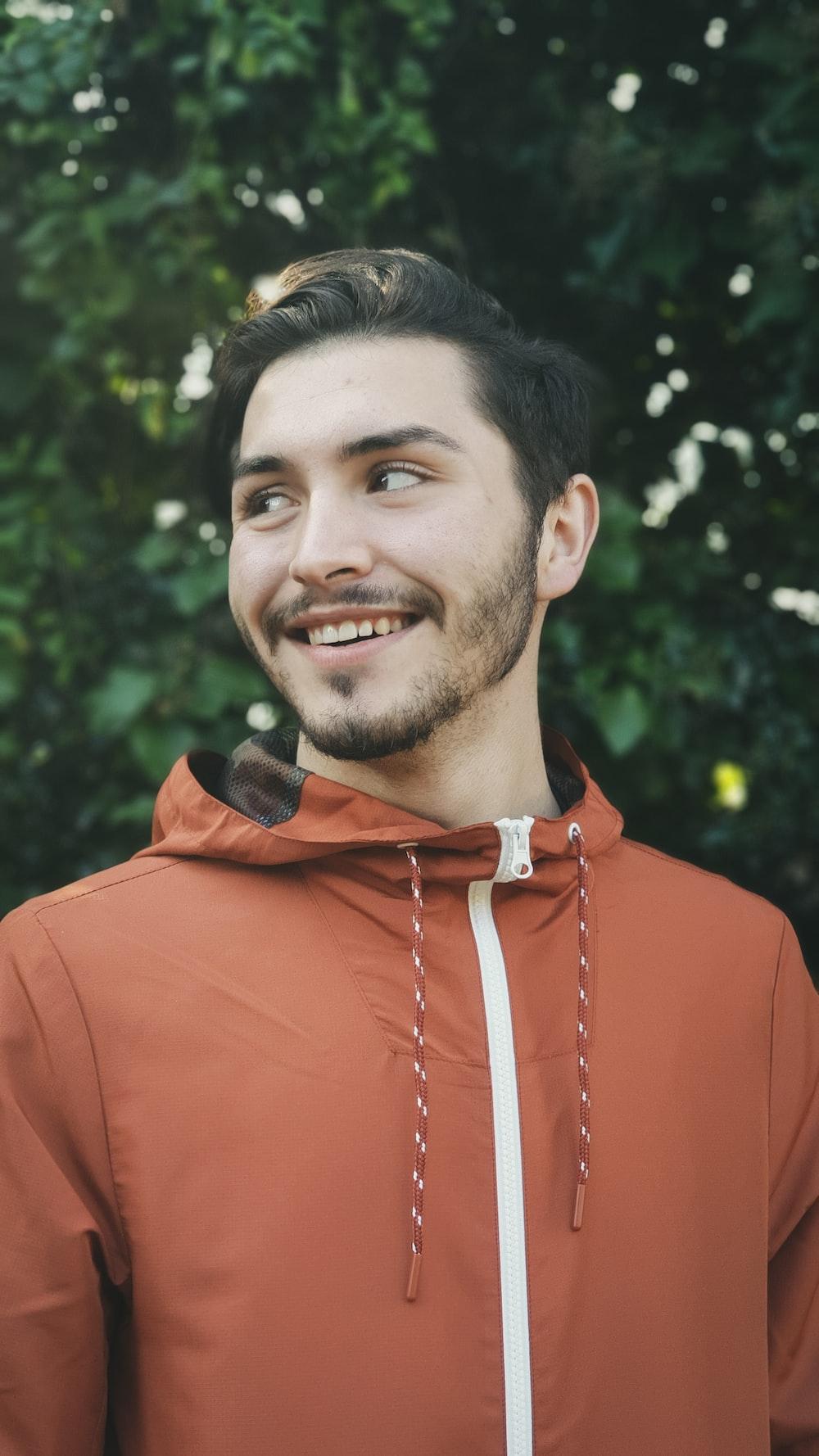 man in red hoodie smiling