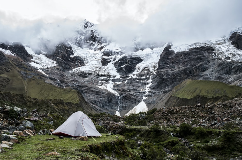 gray dome tent near mountain during daytime