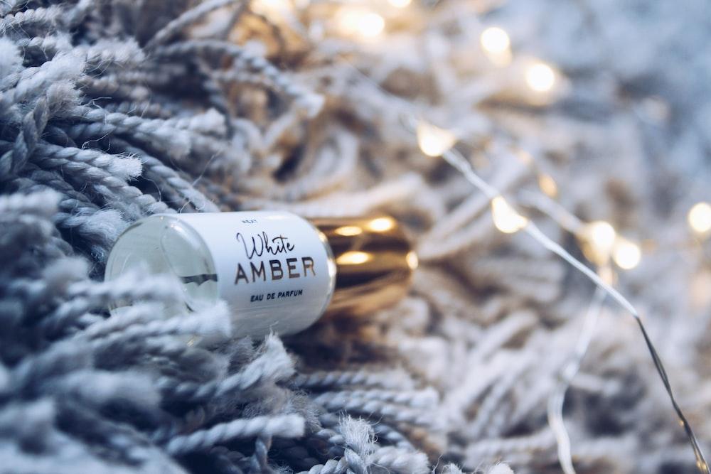 white Amber glass bottle on rug