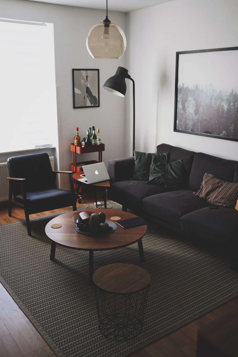 black book on brown wooden coffee table