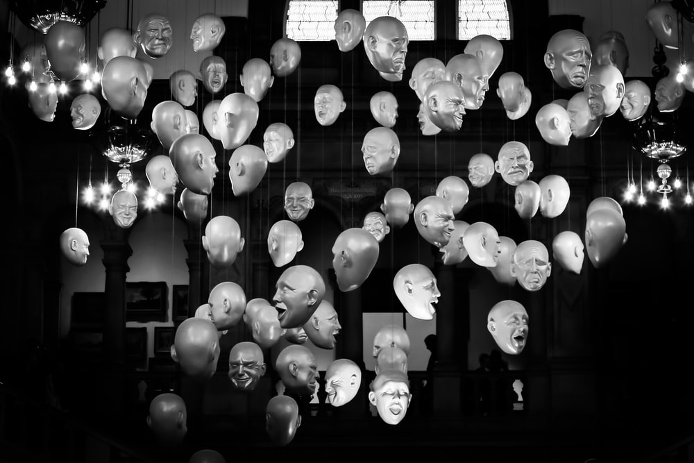 grayscale photography of human head mannequin hanging decors