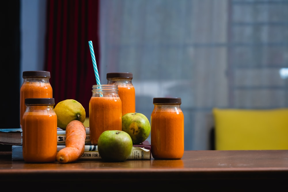 carrot juice on mason jar