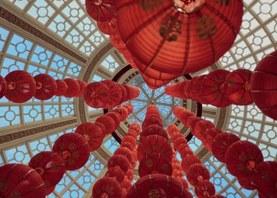 red lanterns hanging on white ceiling lunar new year teams background