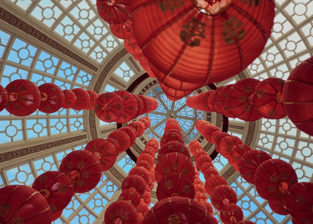 red lanterns hanging on white ceiling
