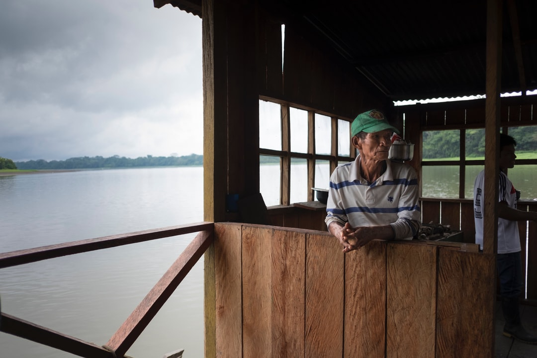 A fisherman in his cabin on top of the lake