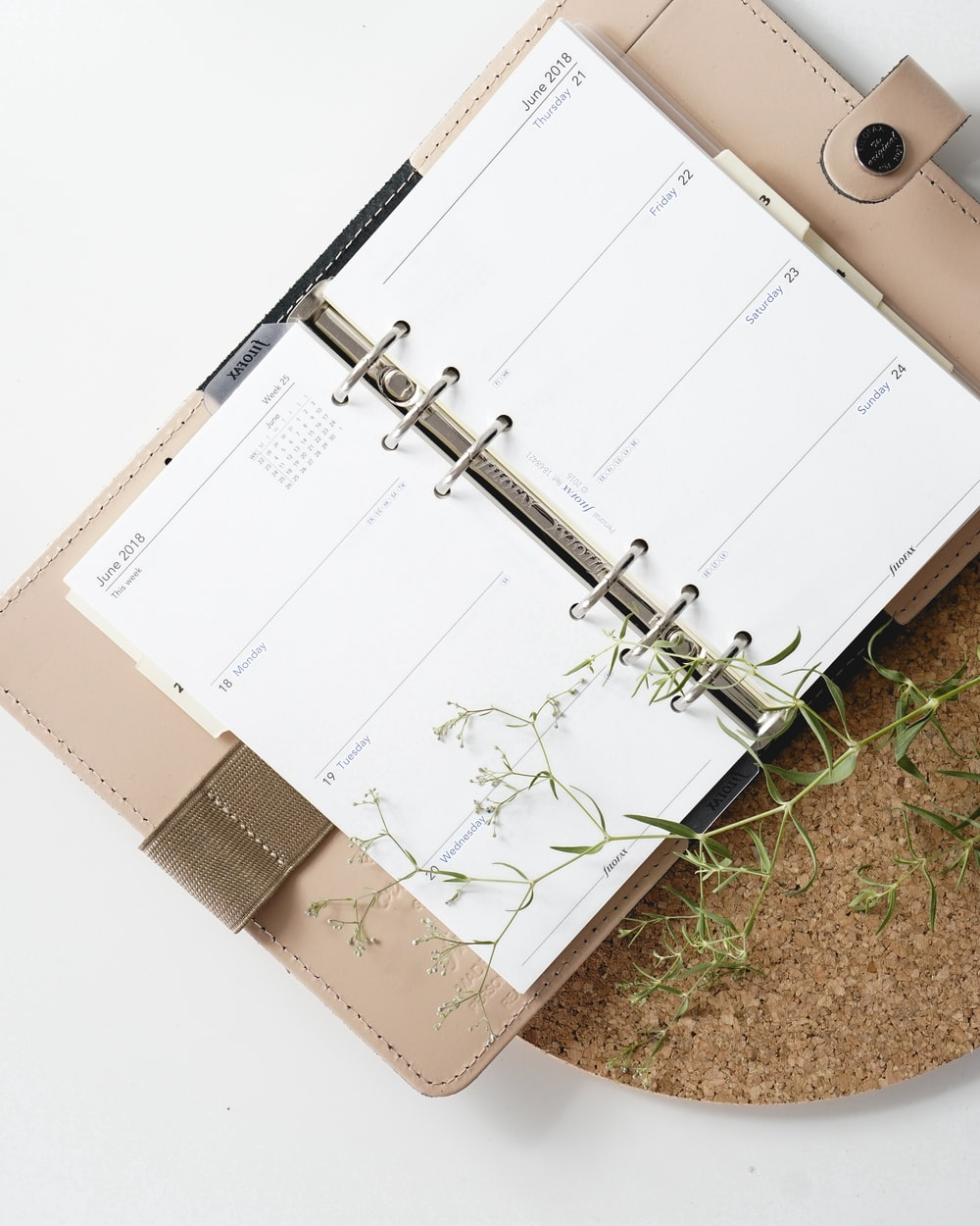 white and browm notebook