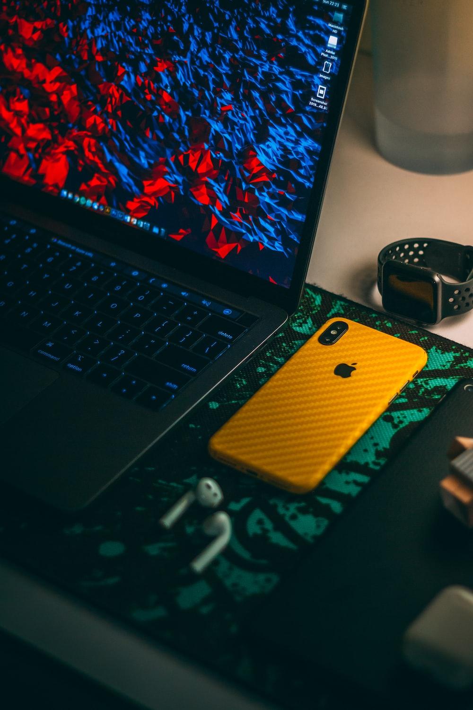 MacBook Pro beside iPhone X