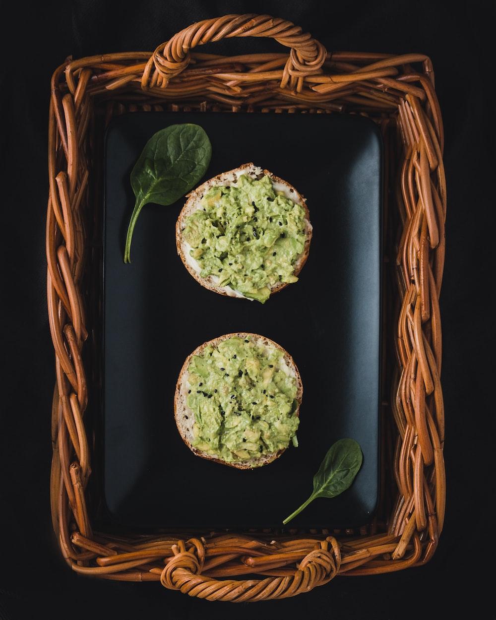 two baked cookies on brown wicker basket