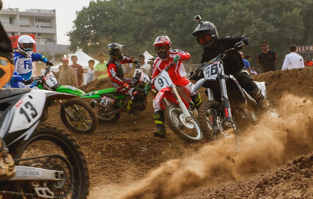 four men riding dirt bikes