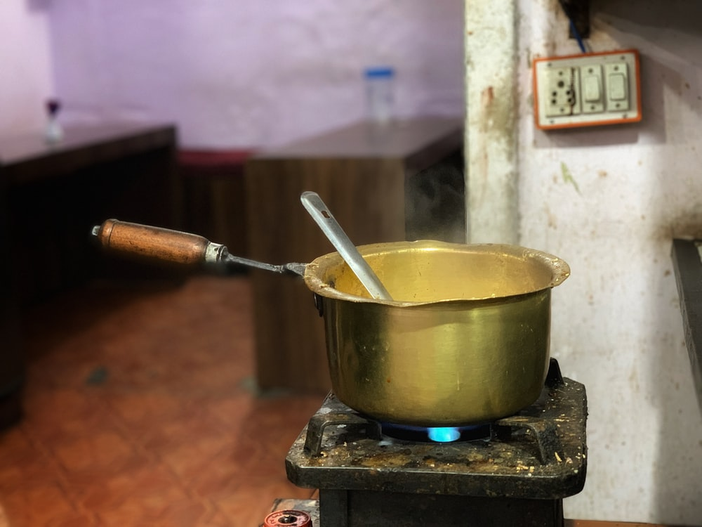 brass-colored cooking pot