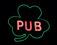green and red Pub signage