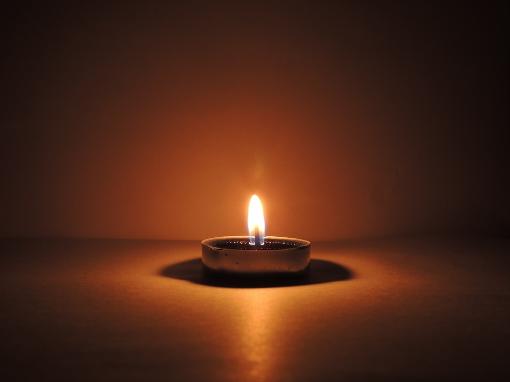 round ceramic bowl with lighted candle