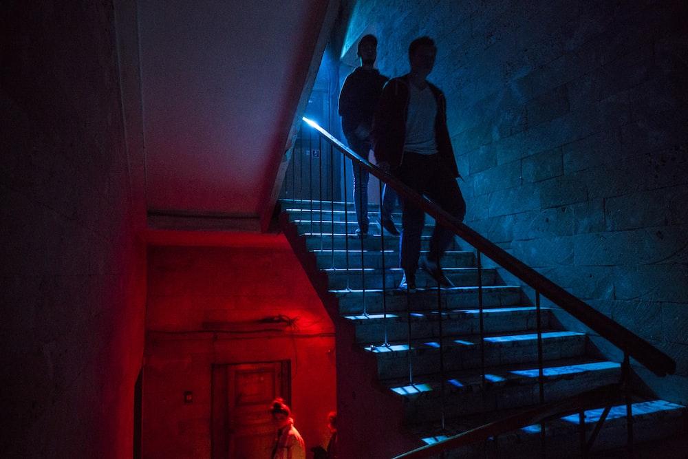 two men walking down staris