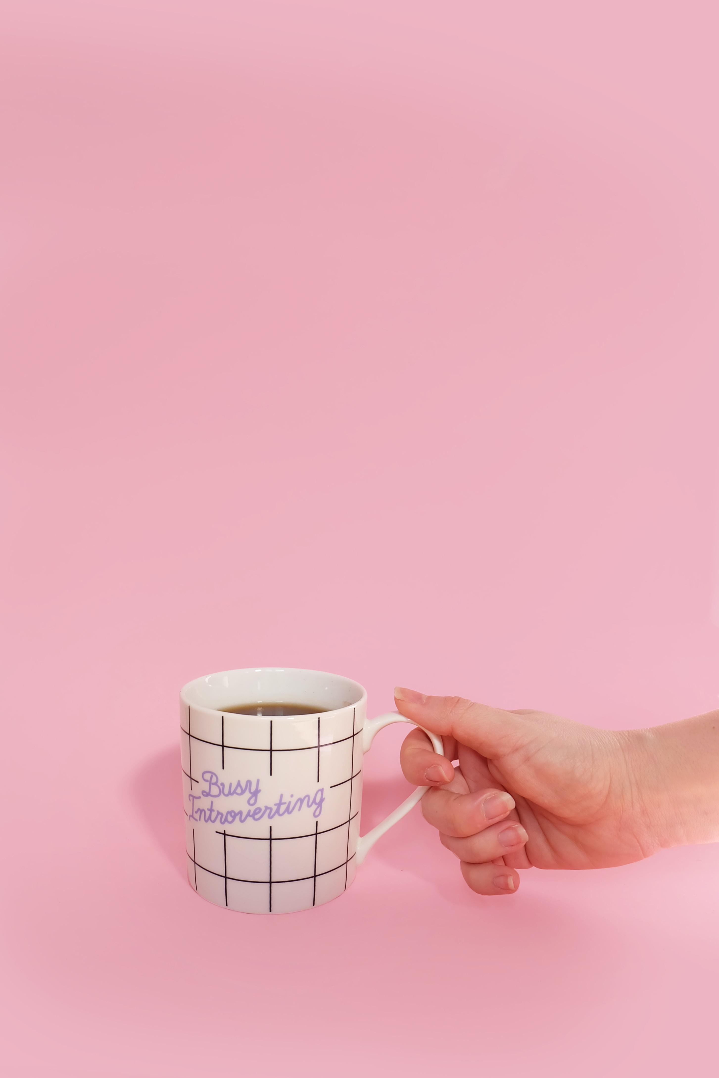 White Mug with a hand