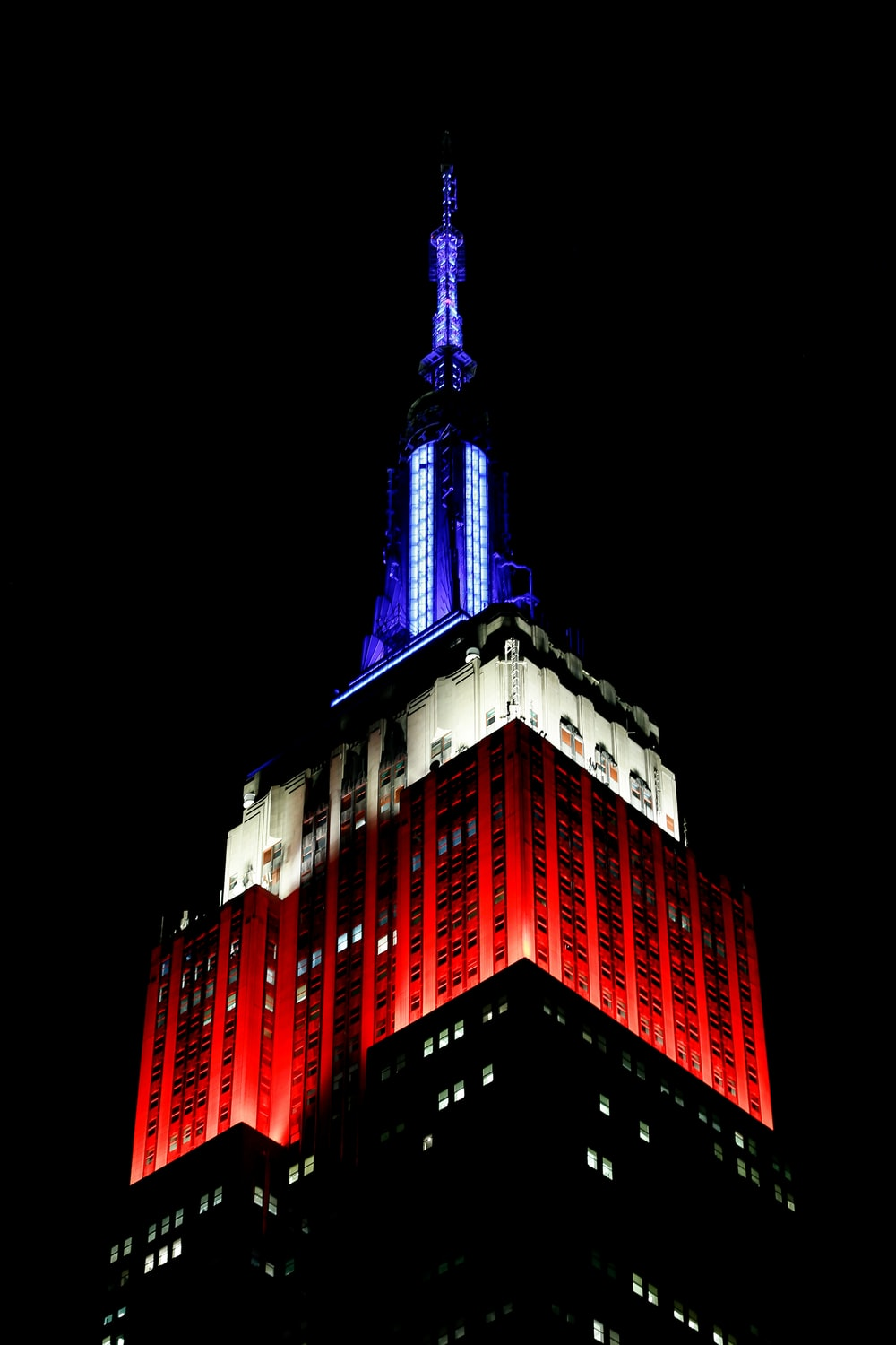 architectural photography of red, white, and blue building