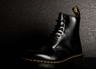 unpaired black leather boot