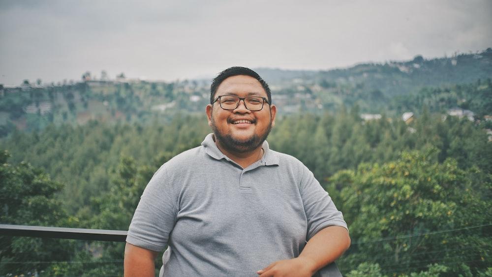smiling man leaning on baluster