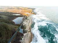 aerial photography of road near sea during daytime