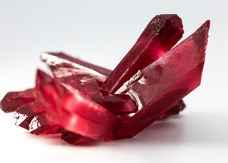 selective focus photo of red gemstone