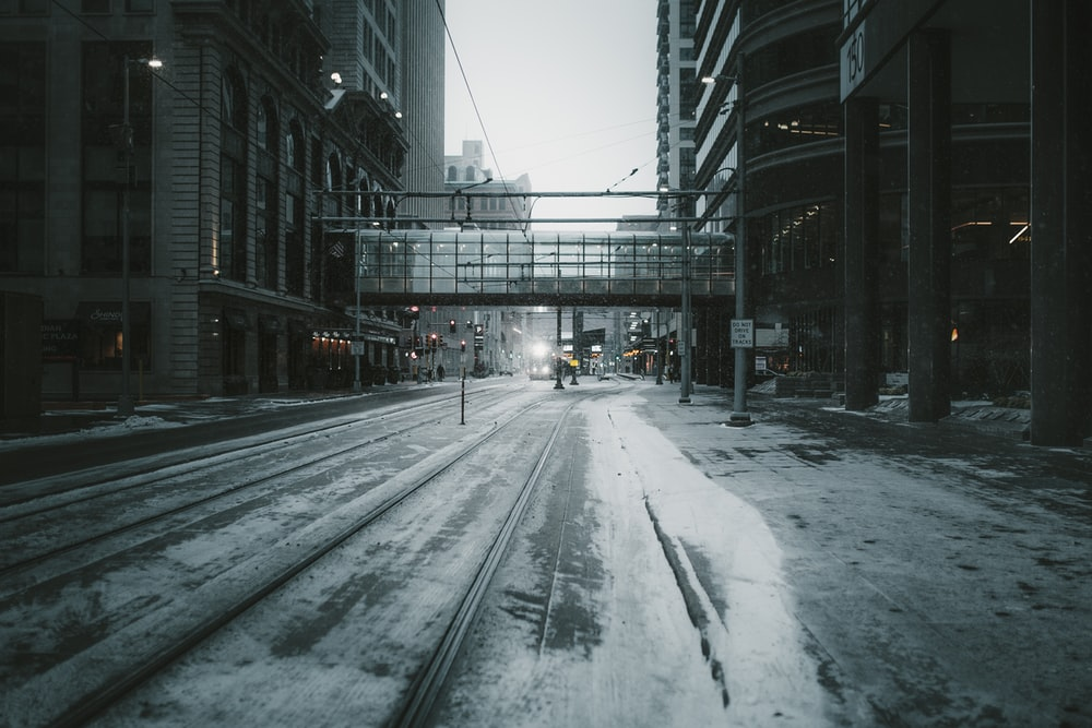 gray empty road across building bridge
