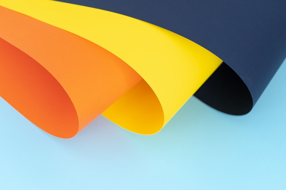 orange, yellow and blue papers